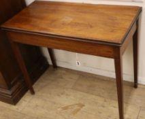 A George III rectangular mahogany folding tea table W.89cm