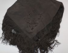 A Chinese embroidered black satin shawl, c.1900