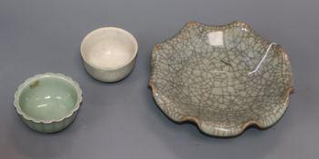 A Chinese celadon crackle glaze brush washer, a similar tea bowl and a celadon glazed tea bowl