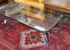 A wrought iron framed coffee table, with plate glass top W.120cm