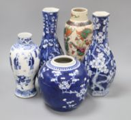 A pair of Chinese blue and white vases, a similar jar (lacking cover), a figural vase bearing Kangxi