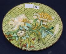 A Doulton lambeth faience dish, by Fanny Stable, c.1880, painted with chrysanthemums diameter 31.
