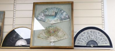 A framed pair of painted fans and two others, (three hand painted)