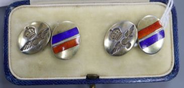 A cased pair of sterling and three colour enamel military related oval cufflinks.