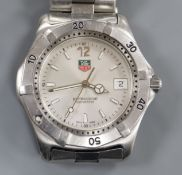 A gentleman's stainless steel Tag Heuer Professional quartz wrist watch, no box or papers.