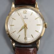 A gentleman's 1960's 9ct gold Tudor manual wind wrist watch, with later associated leather strap.