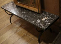 A rectangular wrought iron marble top coffee table L.121cm