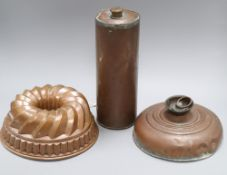 A 19th century copper jelly mould and two copper hot water bottles