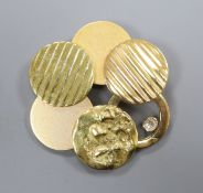 A yellow metal multiple disc brooch (tests as 18ct) set with a single diamond, gross 24.9g, 46mm.