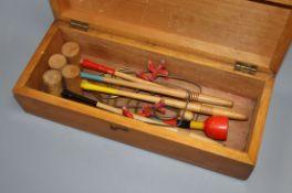 A Victorian miniature croquet set