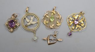 Five assorted early 20th century and later yellow metal and gem set pendants, including three 9ct.