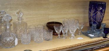 A part suite of Webb & Corbett table glassware, three decanters, a matched dressing table set and