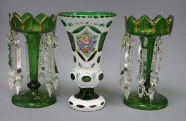 A pair of Victorian green glass table lustres and a 1950's Bohemian green and white layered glass