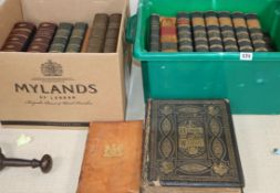 A collection of leather cloth bound books and a bible