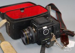 A Zenza Bronica SQ camera with film back and Zenzanon-S 1=2.8 f=80mm lens, cased