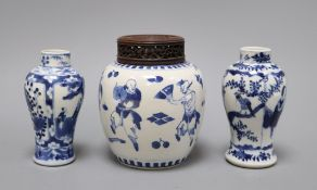 A 19th century Chinese blue and white ovoid jar, wood cover and two similar smaller vases tallest