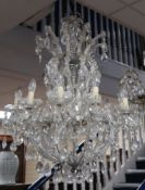A large ten branch cut glass chandelier H.97cm