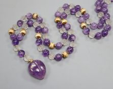 Kai-Yin Lo, Hong Kong, an amethyst, reeded glass and 14k bead necklace with carved fruit pendant, (