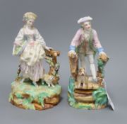 A pair of Paris porcelain figures of a man and his dog on a bridge, and a lady and her dog tallest