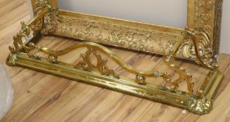 A Victorian brass fender L.125cm