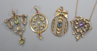Four assorted early 20th century 9ct and gem set pendants including one with 9ct chain.