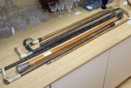 Six horn handled walking sticks and a silver topped walking stick