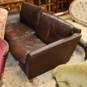 A Marks & Spencer brown leather sofa W.220cm