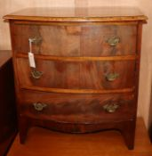 A small mahogany three drawer bow front chest W.66cm