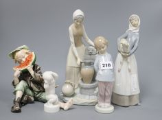 A collection of six Lladro and Nao figures tallest 28cm