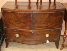 A 19th century bowfront mahogany cabinet W.107cm
