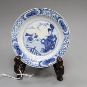 A Chinese blue and white 'boy and lady' dish, Kangxi, with stand diameter 10cm