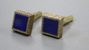 A pair of 1970's textured 9ct gold and lapis lazuli set cufflinks, gross weight 13 grams.