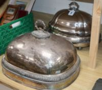A silver-plated meat dish and dome, height 36cm and a separate dome