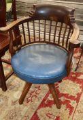 A late Victorian mahogany revolving desk chair