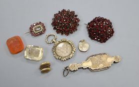 Two garnet brooches, two intaglio cut stones, a Victorian garnet and seed pearl set mourning brooch,