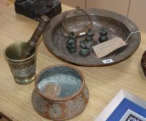 A group of mixed Eastern metalwares including pestle and mortar, weights, copper basin, etc. largest