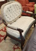 A Victorian carved rosewood open arm settee W.132cm