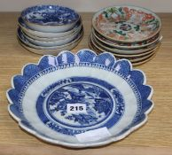 A group of 18th/19th century Chinese famille rose and blue and white saucers dishes tallest 23cm