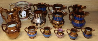 A group of Staffordshire copper lustre jugs
