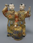 A Satsuma pottery group of two boys drumming height 28cm