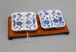 A pair of Chinese blue and white square dishes, Guangxu mark and period, hardwood stand