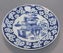 A large Chinese blue and white 'Antiques' dish, 19th century diameter 38cm