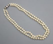 A double-row cultured pearl choker necklace with diamond and ruby-set white metal clasp, 39cm.