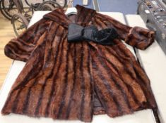 A fur coat and tie