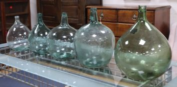 Five green glass carboys