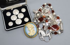 A silver charm bracelet and other jewellery including costume.