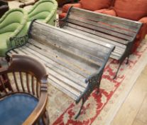 A pair of Victorian style slatted garden benches L.126cm