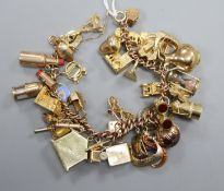 A 9ct charm bracelet hung with assorted charms, including bicycle, cathedral, cannon and minor's