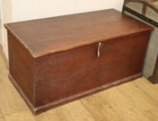 A Victorian pine trunk with painted grain W.110cm