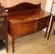 A 1920's mahogany bow front wash stand W.116cm